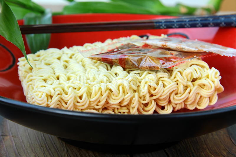 Instant Asian noodle fast food with chopsticks stock photography