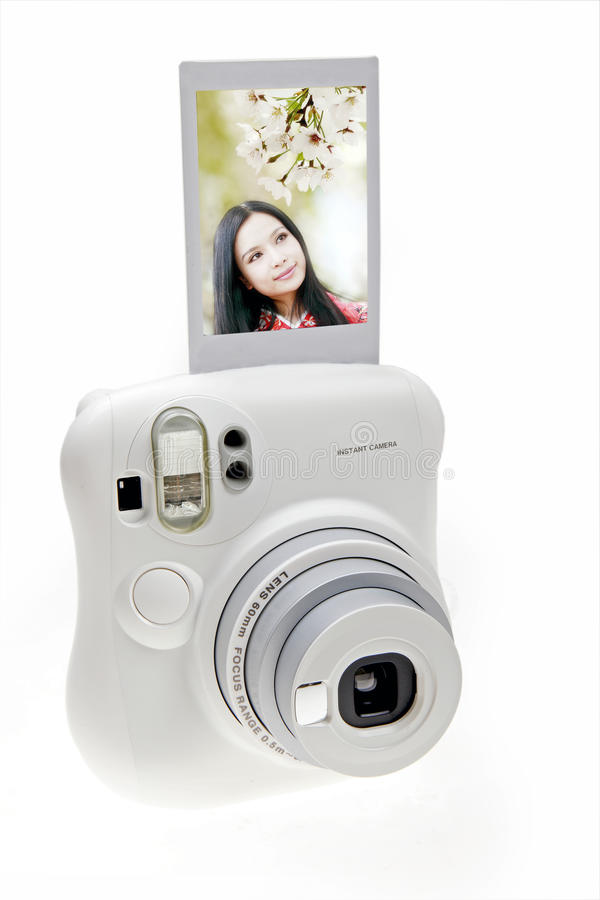 Instant camera. An instant camera with a photo isolated on white stock photo