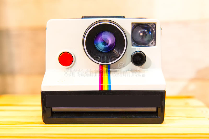 Instant camera or Polaroid Land Camera on wood table. royalty free stock images
