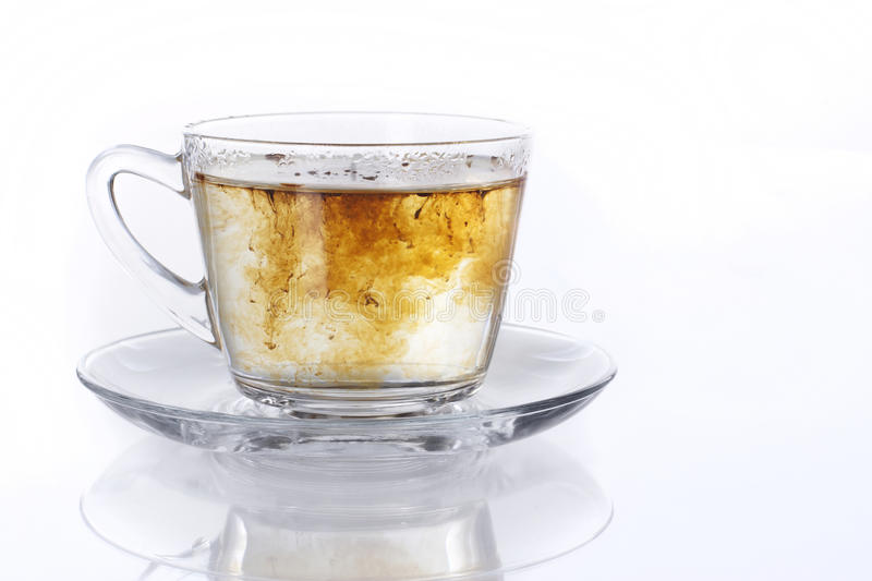 Instant coffee. Mixing into water inside a cup royalty free stock photos