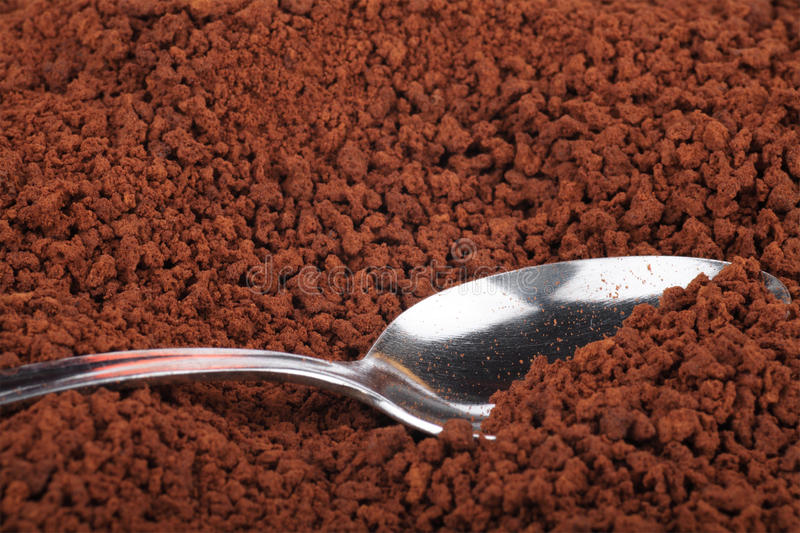 Instant coffee and teaspoon stock images