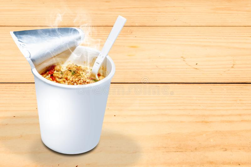 Instant cup noodle with fork royalty free stock image
