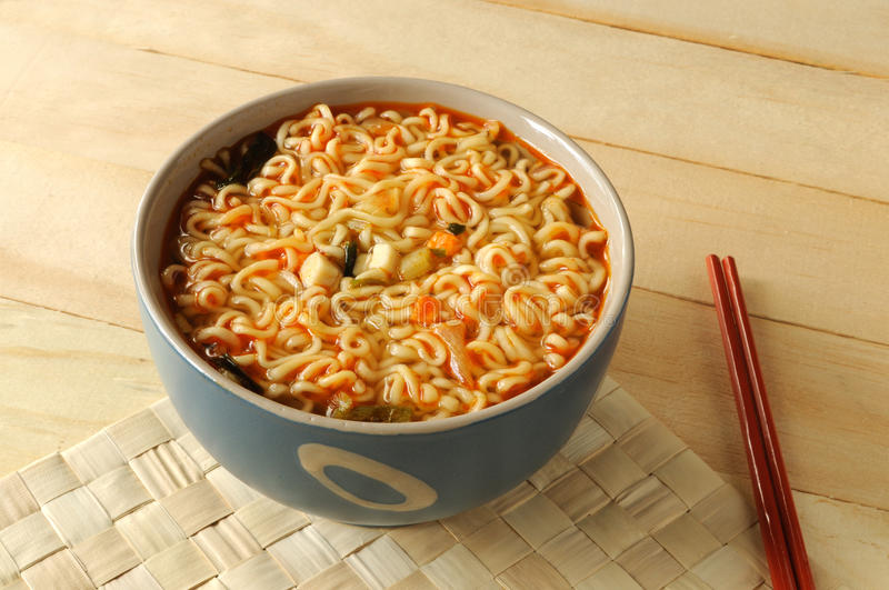 Instant Noodle. In a porcelain bowl with chopsticks stock image