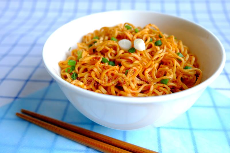 Instant noodle in white ceramic bowl on napery royalty free stock photography