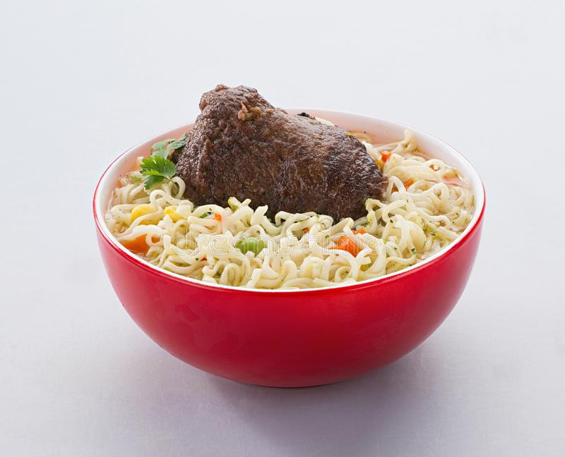 The noodles in the red bowl royalty free stock photo