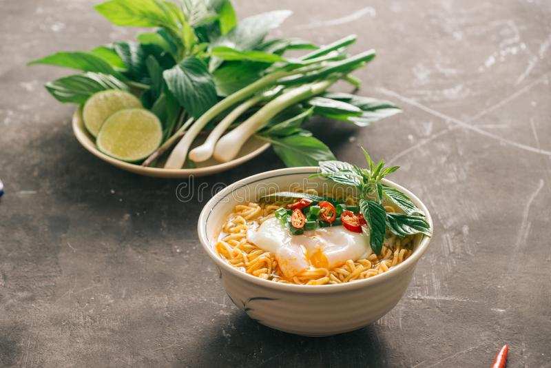 Instant noodles soup put egg and vegetables.  stock photography