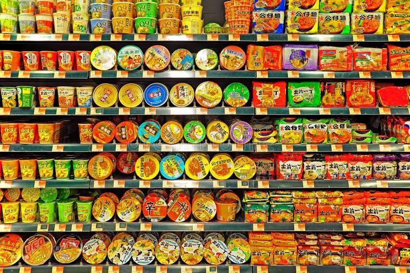Instant noodles on supermarket shelves royalty free stock image