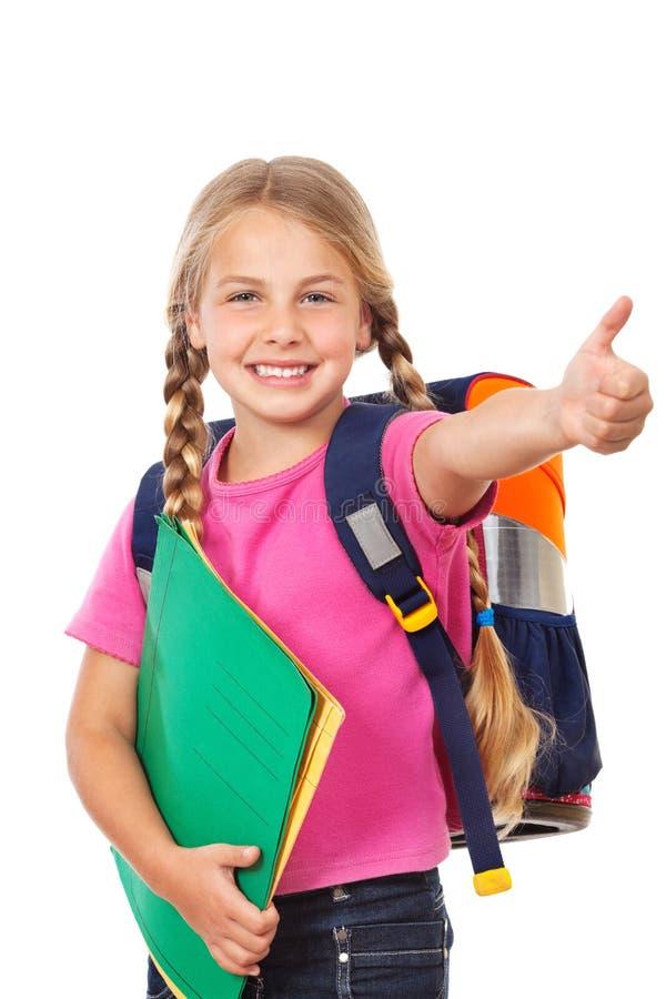 Instrução, schoolbag da menina e polegar acima fotos de stock