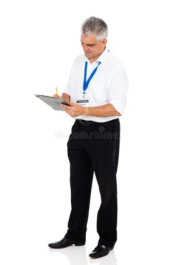 instructeur het schrijven klembord stock afbeelding