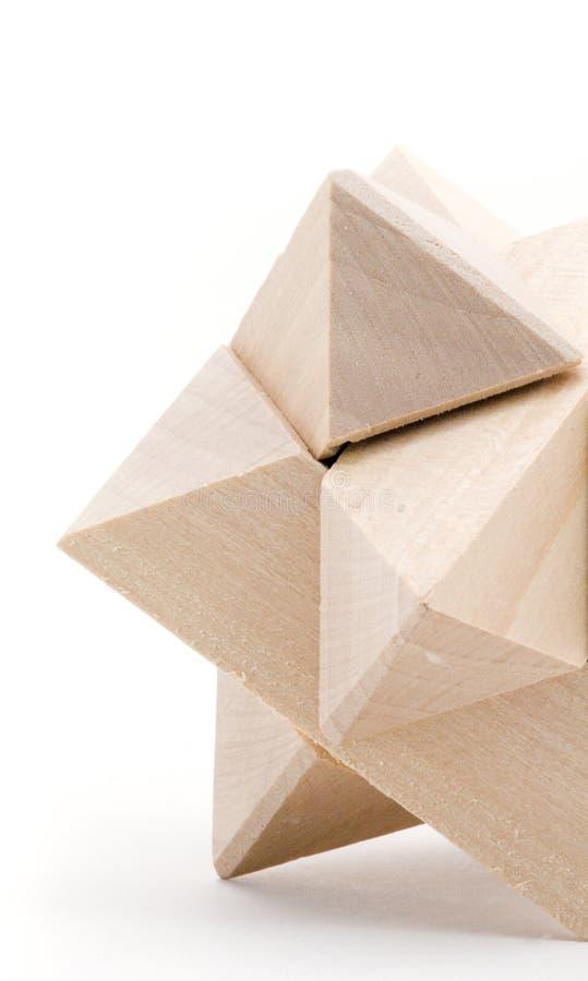 Instruction-macro - puzzle en bois en forme d'étoile images stock