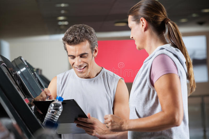 Instructor With Client In Health Club stock photo