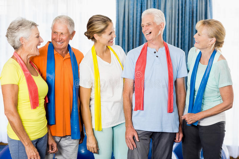 Instructor and seniors with stretching bands. During sports class royalty free stock image