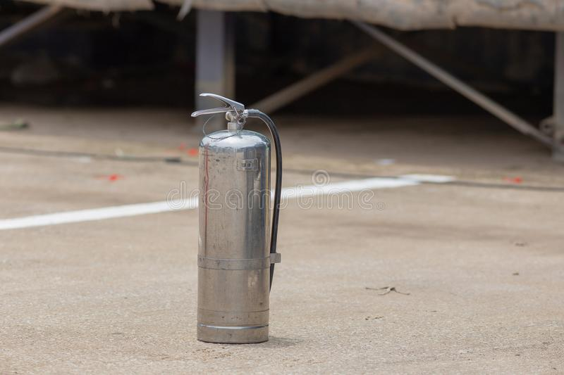 Instructor showing how to use a fire extinguisher on a training royalty free stock images