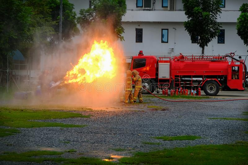 Instructor showing how to use a fire extinguisher on a training stock images