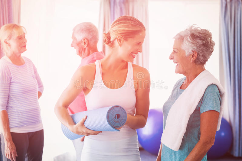 Instructor standing together with seniors royalty free stock images