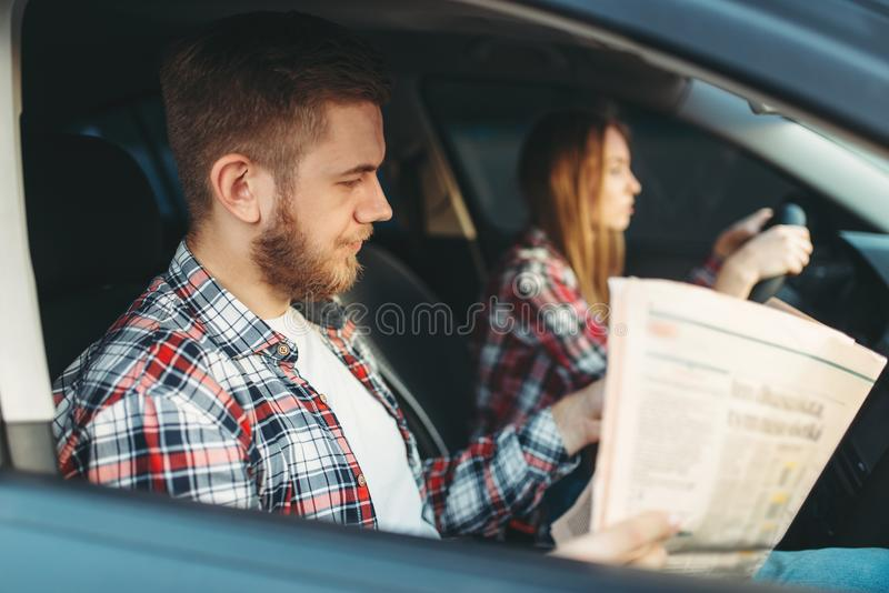 Instructor taking the exam, female student drives royalty free stock image