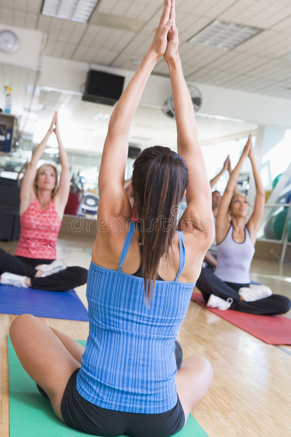 Instructor Taking Yoga Class At Gym royalty free stock photo