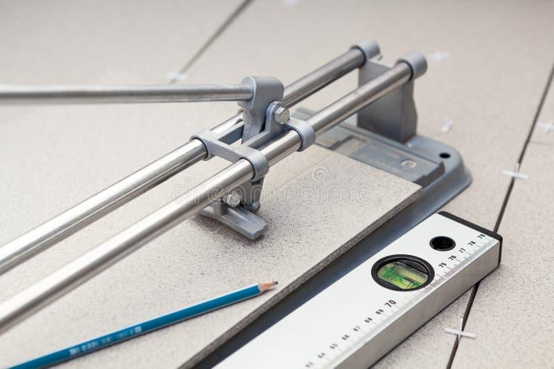 Instrument för tegelplattamarkering, när klippa arkivfoto