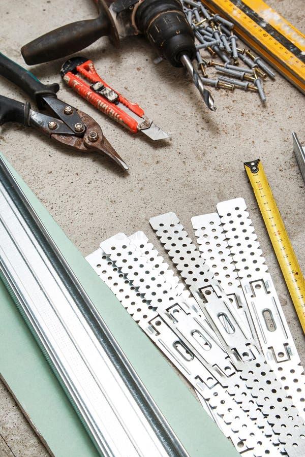 Instrumenten voor bouwstijl een gipsplaatmuren royalty-vrije stock afbeelding