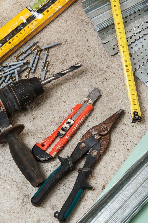 Instrumenten voor bouwstijl een gipsplaatmuren royalty-vrije stock afbeeldingen
