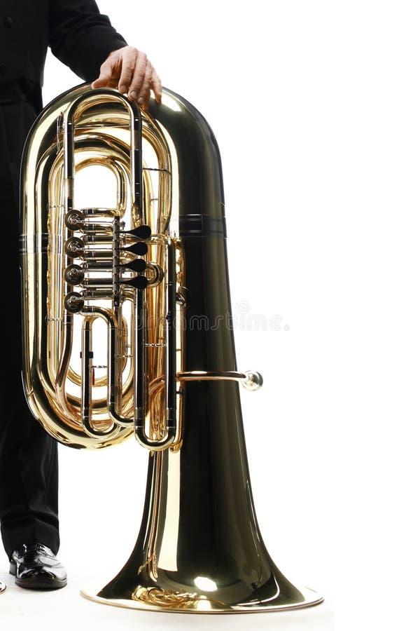 Instrumento de cobre de la tuba aislado imagen de archivo
