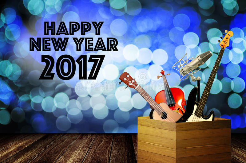 Instrumento de música com palavra do cumprimento do ano novo feliz imagem de stock