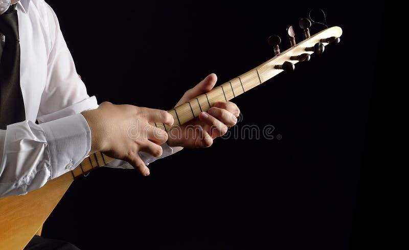 instrumento popular com três cordas dobro fotografia de stock