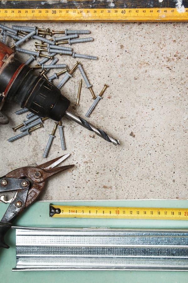 Instrumentos para a construção que uma placa de gesso mura fotografia de stock royalty free