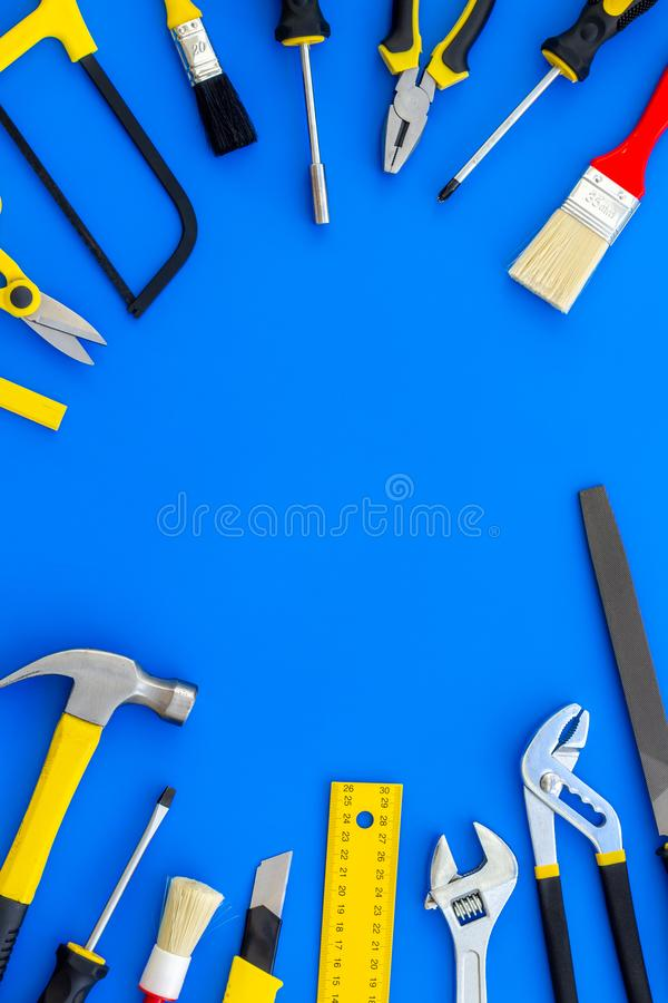 Instruments of constructor for build, paint and repair house on blue background top view mockup. Instruments of constructor for build, paint and repair house on royalty free stock photography