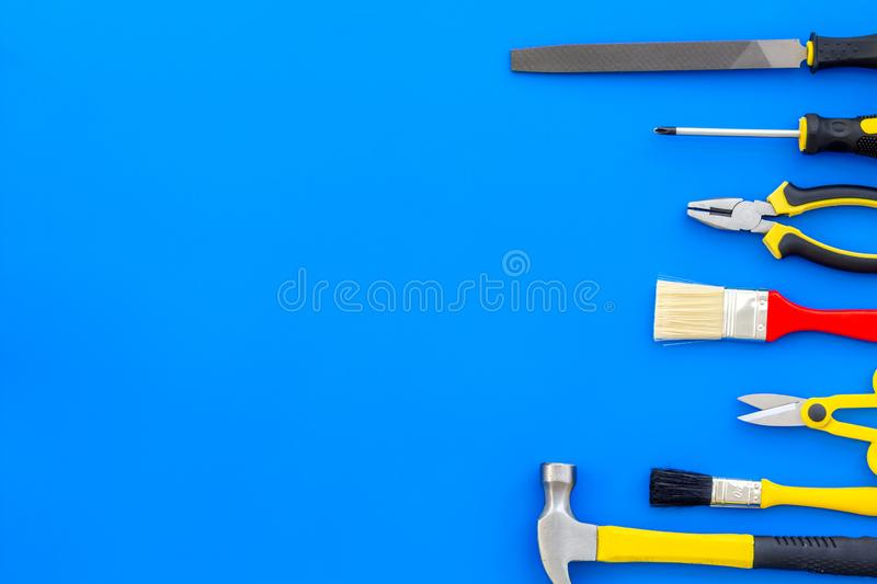 Instruments of constructor for build, paint and repair house on blue background top view mockup. Instruments of constructor for build, paint and repair house on stock photos