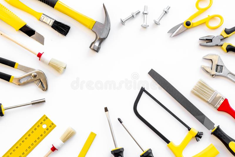 Instruments of constructor for build, paint and repair house on white background top view mockup. Instruments of constructor for build, paint and repair house on stock photos