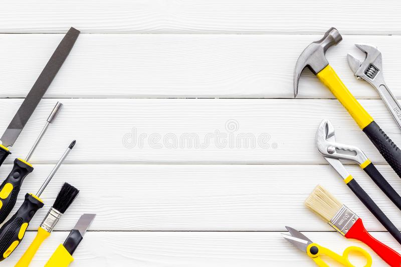 Instruments of constructor for build, paint and repair house on white wooden background top view mockup. Instruments of constructor for build, paint and repair royalty free stock photo