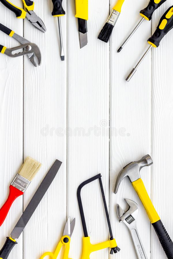 Instruments of constructor for build, paint and repair house on white wooden background top view mockup. Instruments of constructor for build, paint and repair stock images