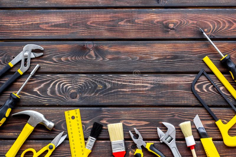 Instruments of constructor for build, paint and repair house on wooden background top view mockup. Instruments of constructor for build, paint and repair house royalty free stock photography