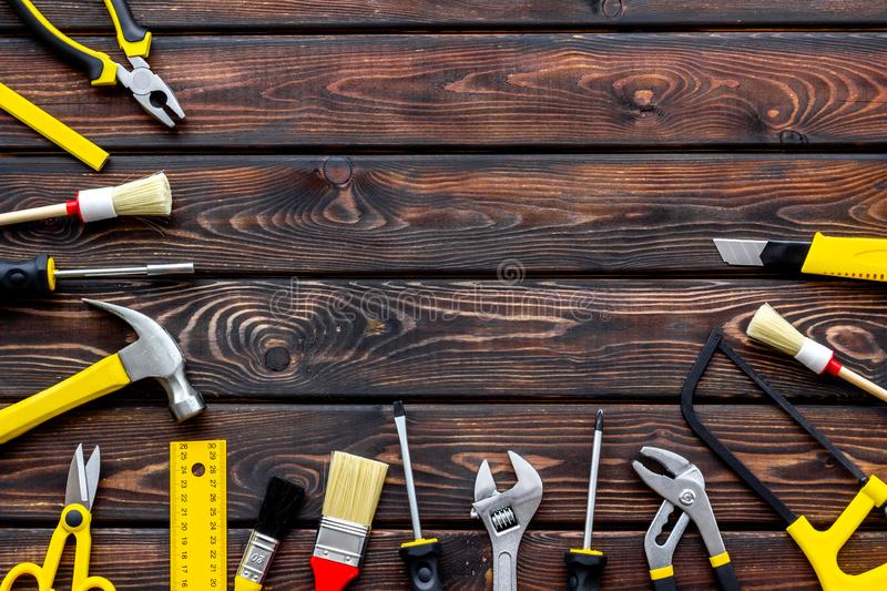 Instruments of constructor for build, paint and repair house on wooden background top view mockup. Instruments of constructor for build, paint and repair house royalty free stock images
