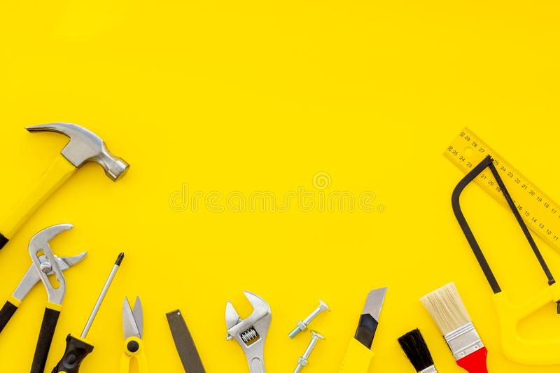 Instruments of constructor for build, paint and repair house on yellow background top view mockup. Instruments of constructor for build, paint and repair house royalty free stock photo
