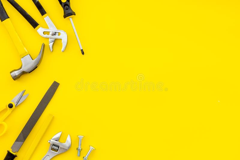 Instruments of constructor for build, paint and repair house on yellow background top view mockup. Instruments of constructor for build, paint and repair house royalty free stock images