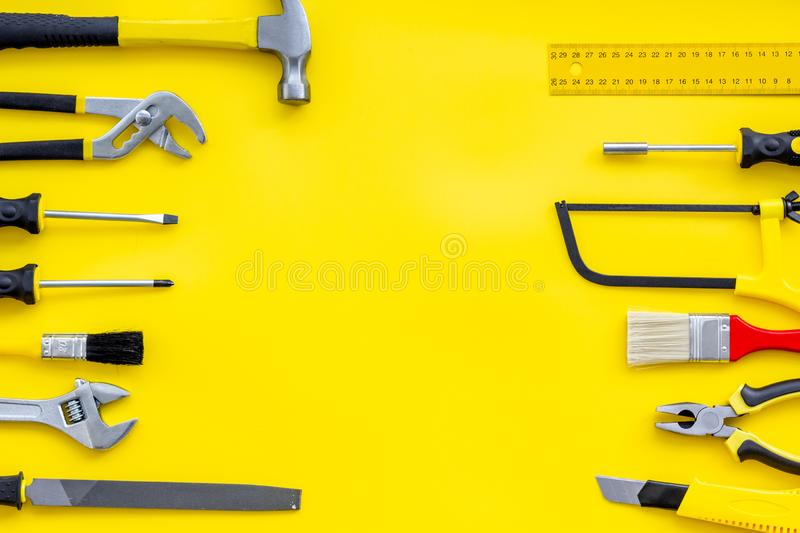 Instruments of constructor for build, paint and repair house on yellow background top view mockup. Instruments of constructor for build, paint and repair house stock photography