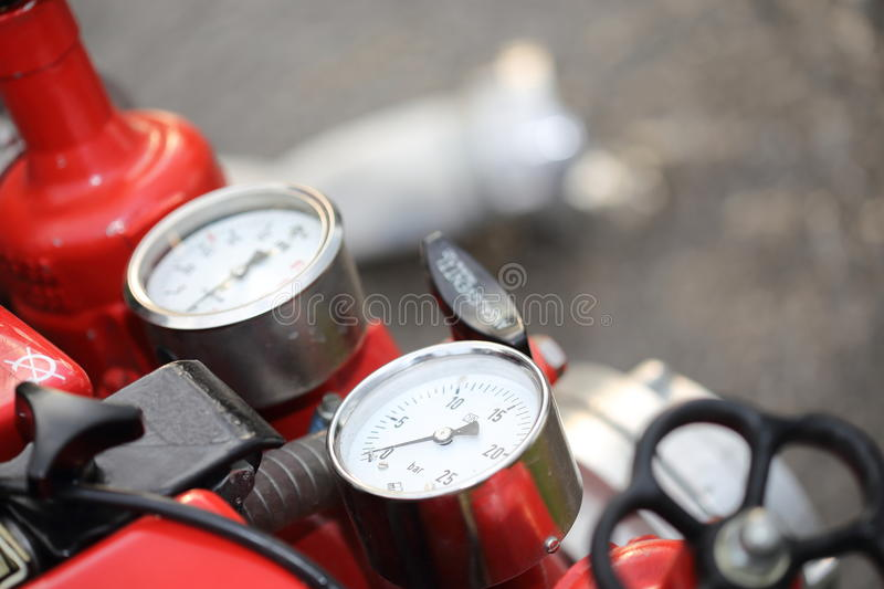 Instruments of a firefighter centrifugal pump. Instruments of a red firefighter centrifugal pump stock photography
