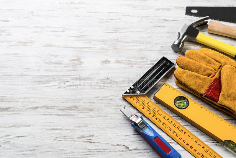 Instruments on wooden table. Variety of repair tools on wooden surface stock photography