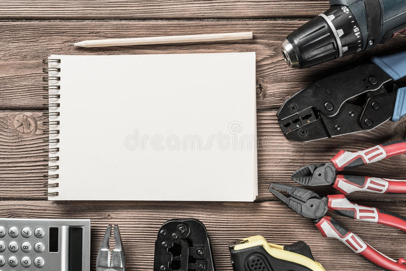 Instruments on wooden table. Variety of repair tools on wooden surface and place for text stock photos