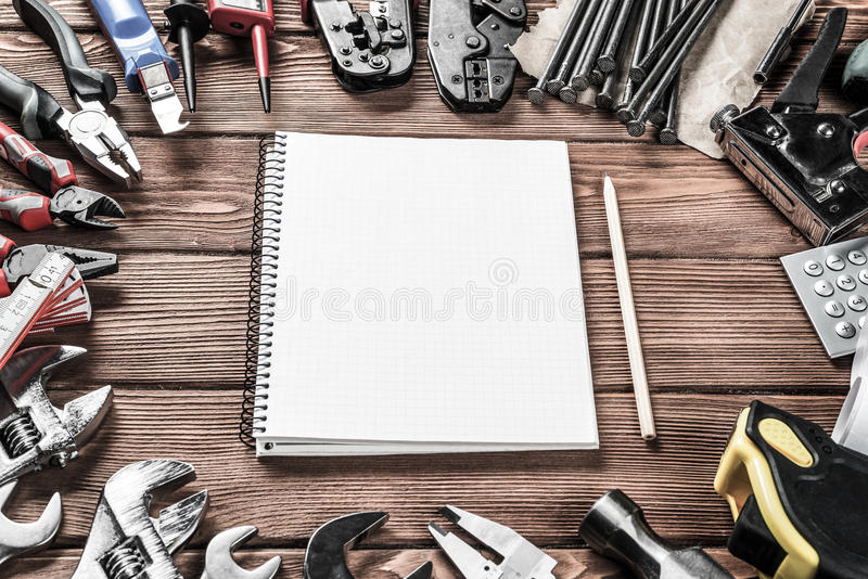 Instruments on wooden table. Variety of repair tools on wooden surface and place for text stock image