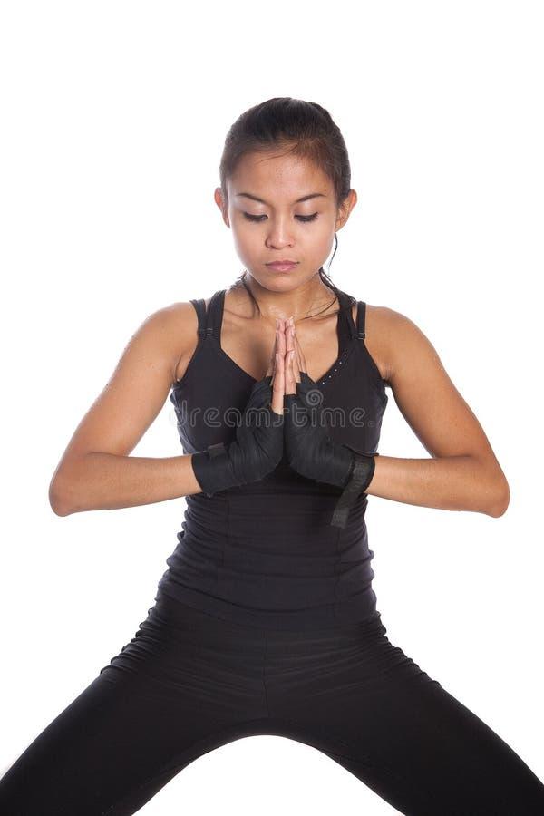 instrutor da aptidão no pose meditating fotografia de stock