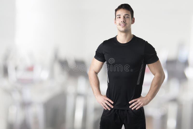 Instrutor pessoal With Hands na cintura imagem de stock