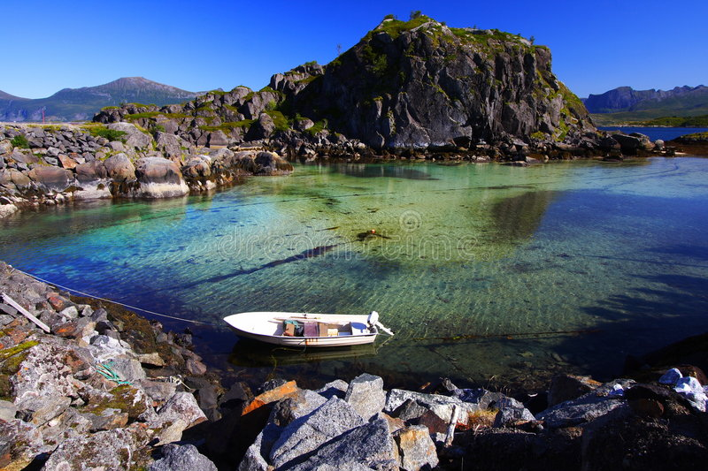 Insulated boat in the Senja island. (Norway) at low tide stock images