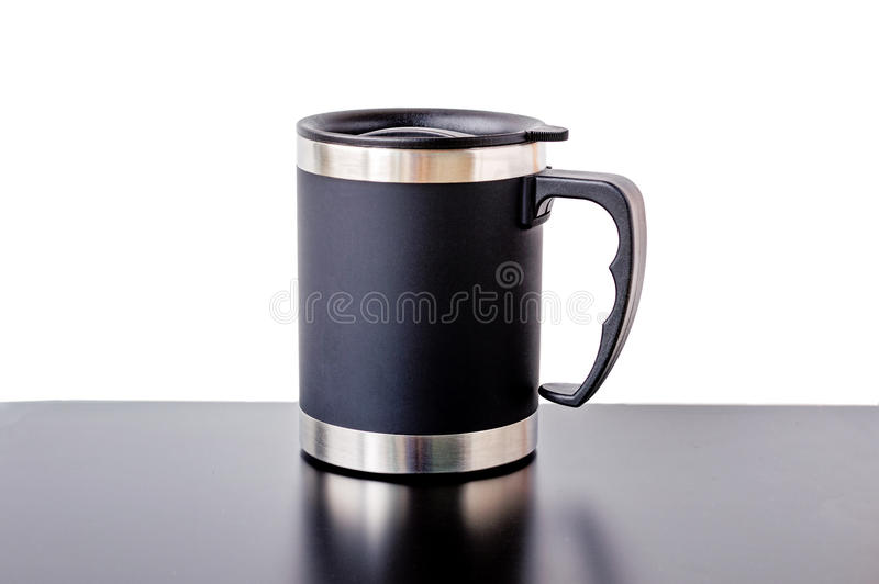 Insulated Cup. Black insulated cup with stainless steel interior and rotating lid with drinking spout with black and white background stock photography