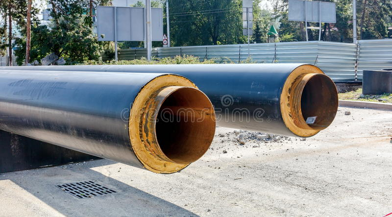 Insulated pipes. Insulated pipes for pipeline construction royalty free stock photos