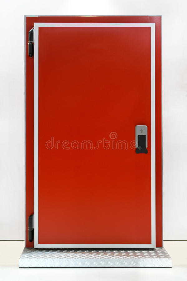 Reefer door. Insulated red door at industrial refridgerator reefer royalty free stock photo