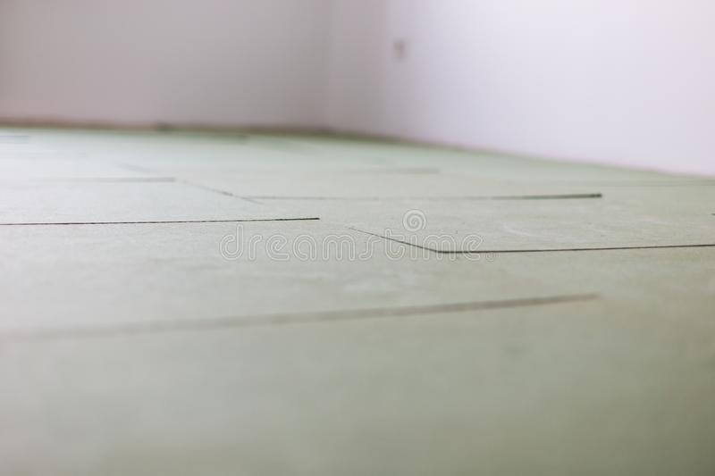 Laying laminate flooring. Insulated underlay on floor ready for the click lock wood effect laminate flooring to be laid. Insulated underlay on floor ready for royalty free stock image