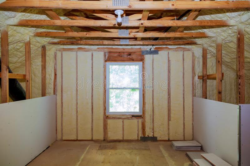 Insulation of attic with fiberglass cold barrier and insulation material. Thermal insulation attic stock photos